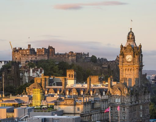 Edinburgh Castle and the Balmoral Hotel clocktower at sunrise