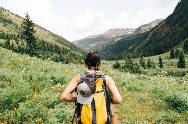hiker walking trough a valley