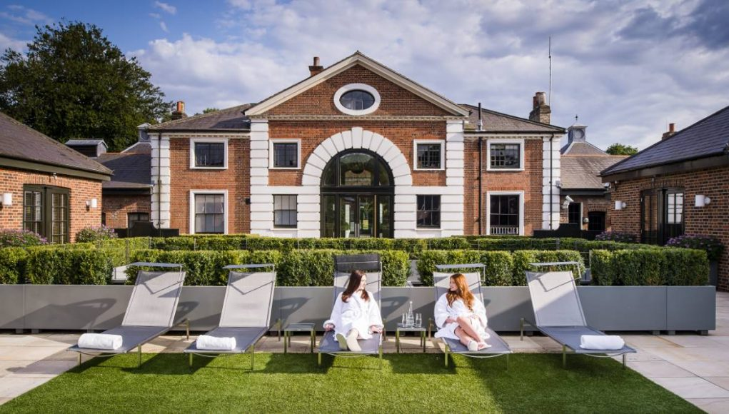 girls on lounge chairs outside a UK spa