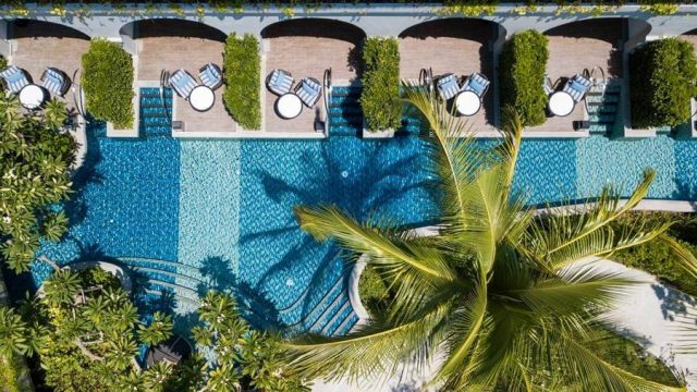 looking down at a hotel pool