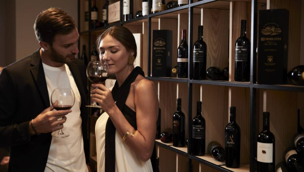 a couple tasting wine at a luxury resort