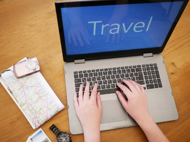booking travel online with a laptop