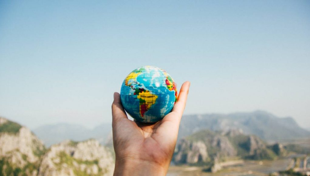 earth day person holding a globe