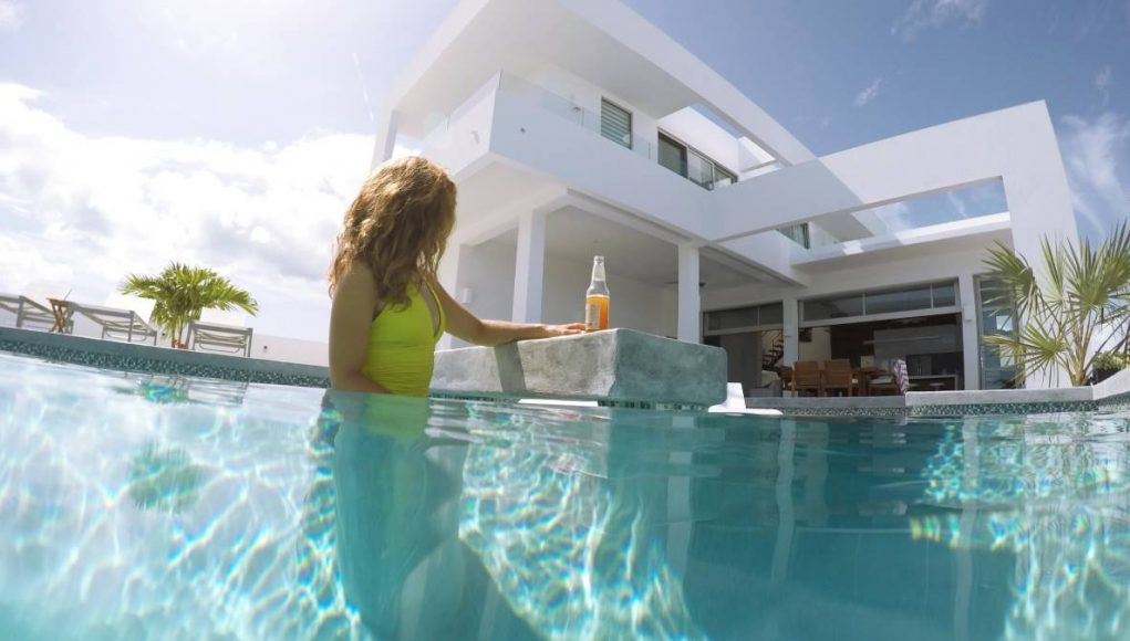 White Villas Turks and Caicos girl in pool