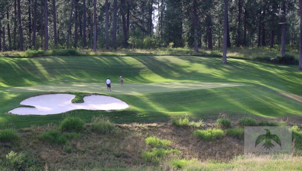 couple playing golf at Circling Raven