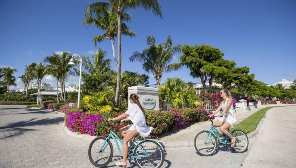two girls riding thier bikes at Ocean Club Resorts