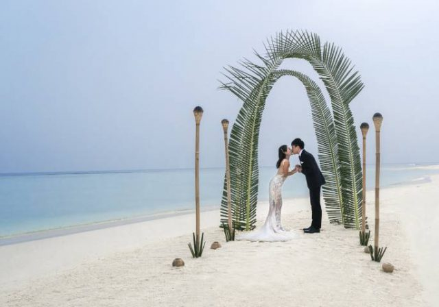 couple getting married on a beach