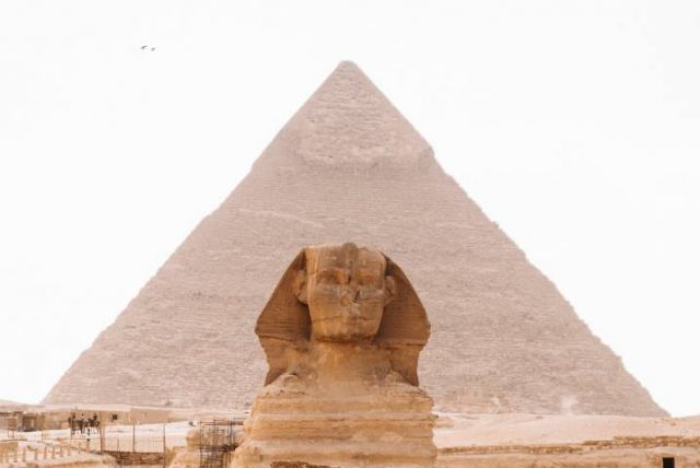 sphinx with pyramid in the background