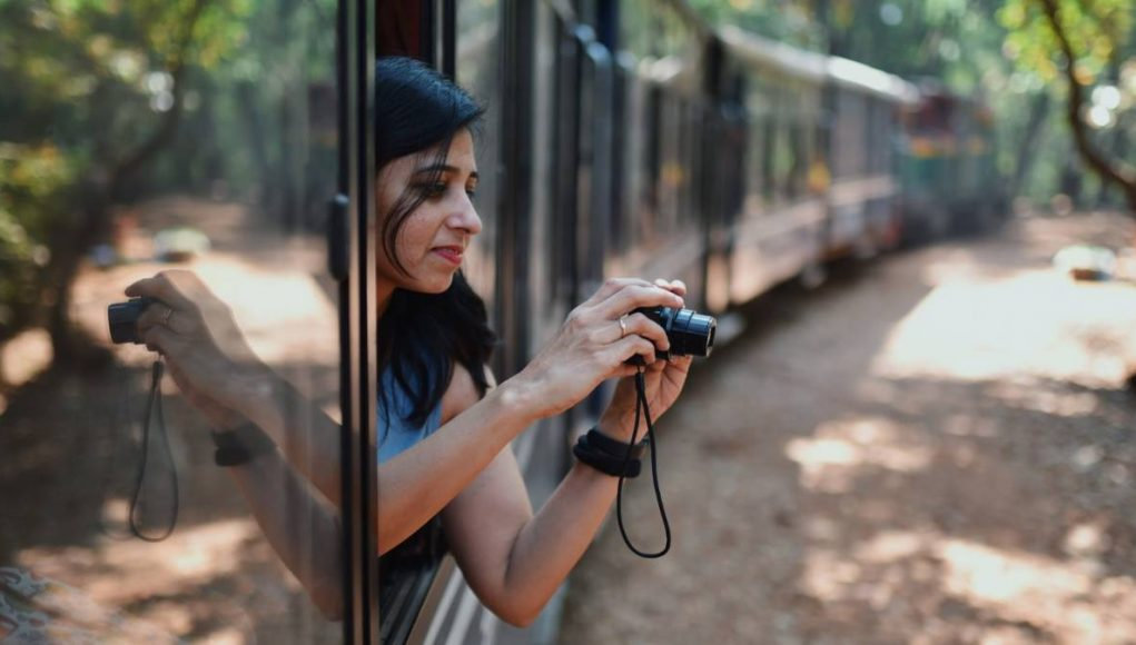 girl taking a photo from a train window