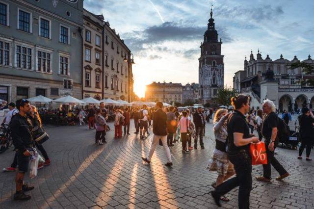 Tourists on Main Market Square in Krakow, Poland.