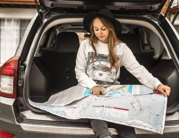 girl reading a map getting ready for a road-trip