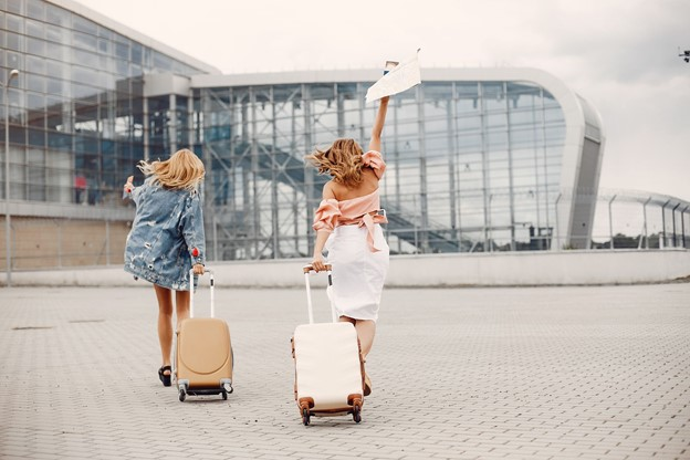 tow girls running to catch a plane