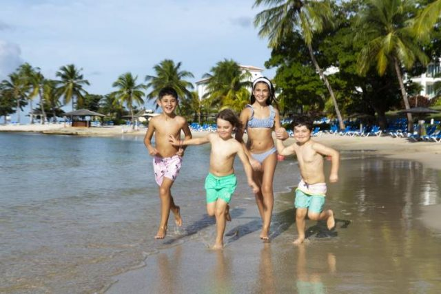 kids running on a beach in St Lucia