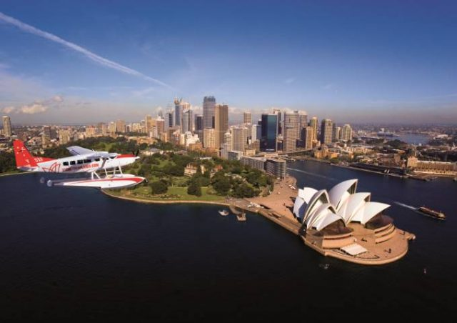A Sydney Seaplane flying over Sydney harbour